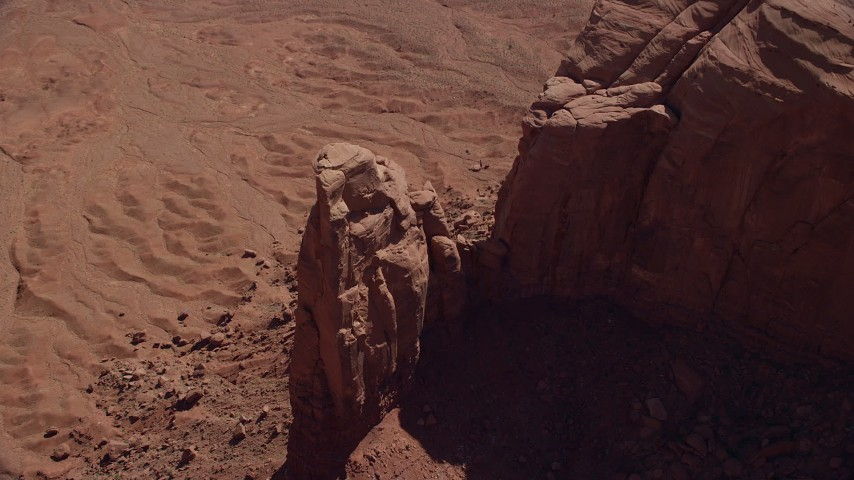 Tilt down, bird's eye view of rock formation, orbit, Monument Valley, Utah, Arizona Aerial Stock Footage | AX135_033