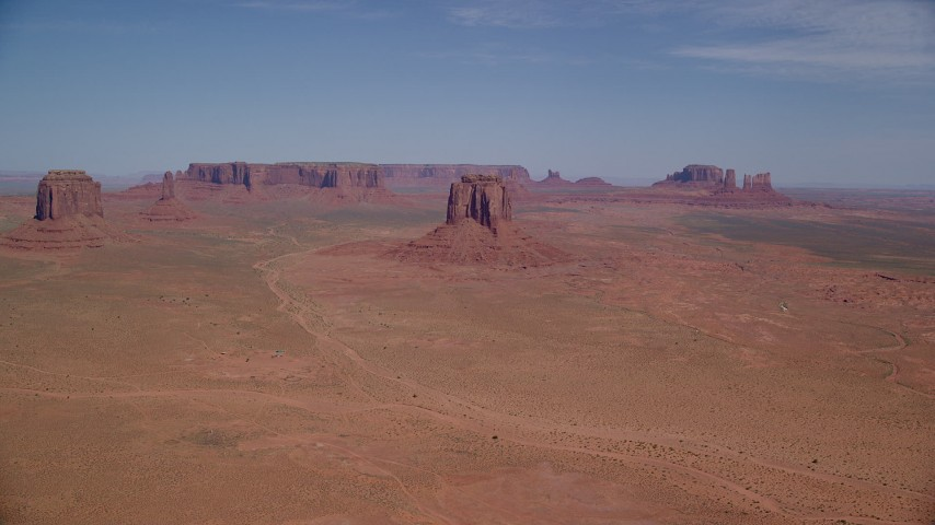 Flying by buttes and mesas, Monument Valley, Utah, Arizona Aerial Stock Footage | AX135_034
