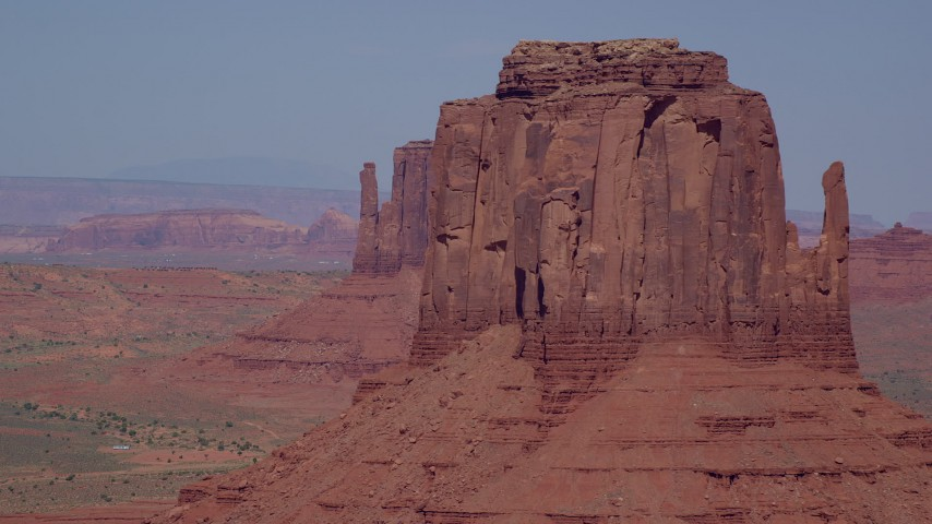 Flying by West Mitten Butte, East Mitten Butte, Monument Valley, Utah, Arizona Aerial Stock Footage | AX135_037