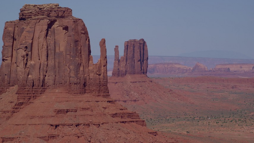Flying by East Mitten Butte, reveal West Mitten Butte, Monument Valley, Utah, Arizona Aerial Stock Footage | AX135_038