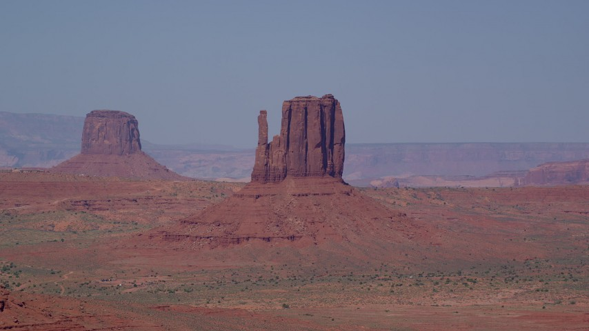 Flying by Mitchell Butte, West Mitten Butte, Monument Valley, Utah, Arizona Aerial Stock Footage | AX135_039