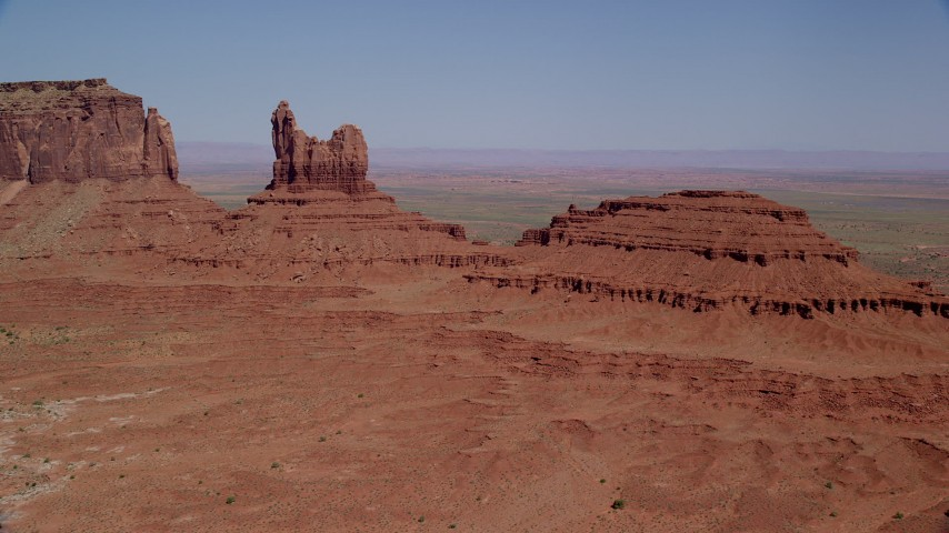 Approaching Setting Hen Butte, Monument Valley, Utah, Arizona Aerial Stock Footage | AX135_050