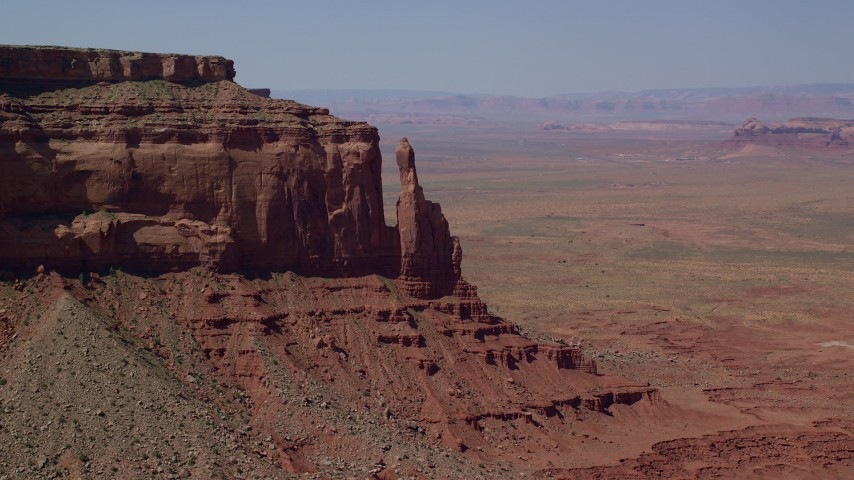 Flying by Eagle Rock Butte, Eagle Mesa, Monument Valley, Utah, Arizona Aerial Stock Footage AX135_054