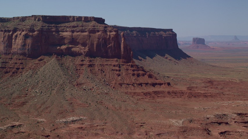 Flying away from Eagle Rock Butte, Eagle Mesa, Monument Valley, Utah, Arizona Aerial Stock Footage | AX135_055
