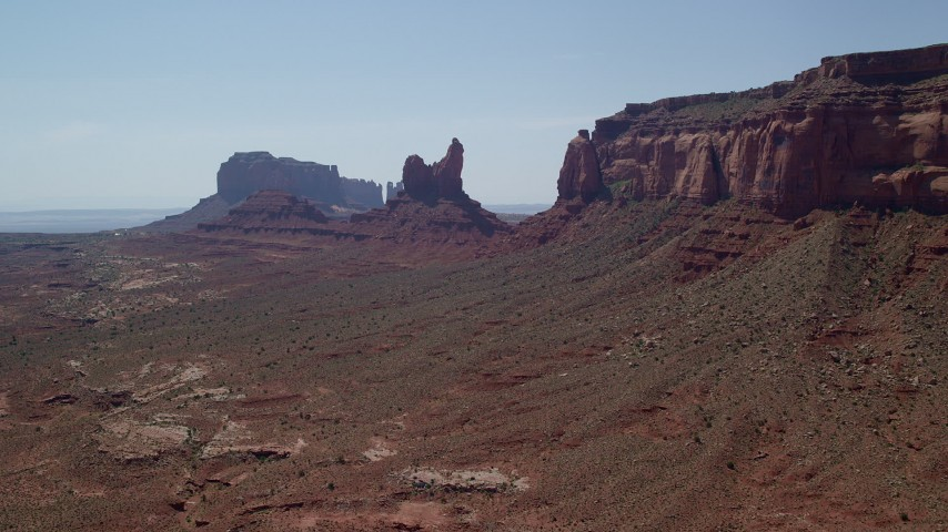 Approaching Setting Hen Butte, Eagle Mesa, Monument Valley, Utah, Arizona Aerial Stock Footage | AX135_057