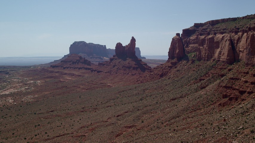 Approaching Setting Hen Butte, Monument Valley, Utah, Arizona Aerial Stock Footage | AX135_058