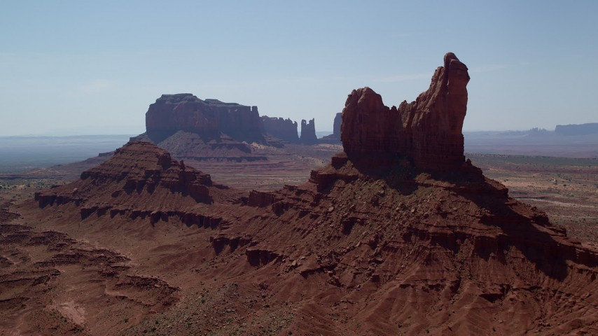 Flying by and approaching buttes, Monument Valley, Utah, Arizona Aerial Stock Footage | AX135_060