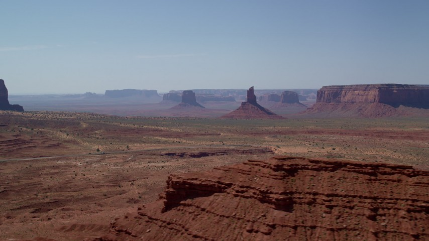 6K stock footage aerial video of a view of Big Indian Butte and Sentinel Mesa, Monument Valley, Utah, Arizona Aerial Stock Footage | AX135_062