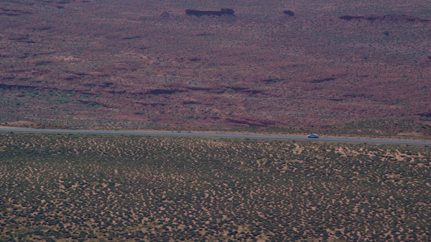 6K stock footage aerial video of tracking car traveling on Highway 163 in Monument Valley, Utah, Arizona Aerial Stock Footage | AX135_066