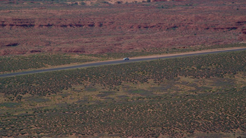 6K stock footage aerial video of tracking car stopped on Highway 163, Monument Valley, Utah, Arizona Aerial Stock Footage | AX135_069