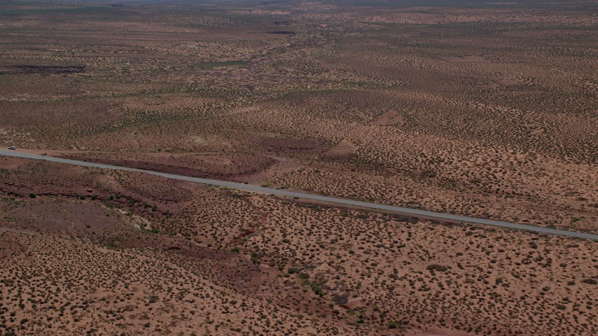 Flying by Highway 163, revealing Forest Gump Point, Monument Valley, Utah, Arizona Aerial Stock Footage | AX135_073