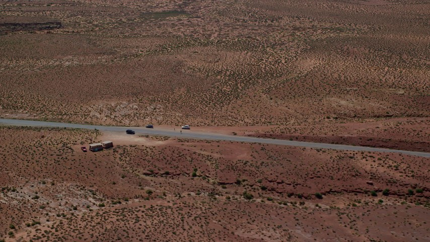 Flying by Highway 163, Forrest Gump Point, Monument Valley, Utah, Arizona Aerial Stock Footage | AX135_074