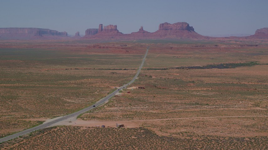 6K stock footage aerial video of approaching Forrest Gump Point and Highway 163, Monument Valley, Utah, Arizona Aerial Stock Footage | AX135_075