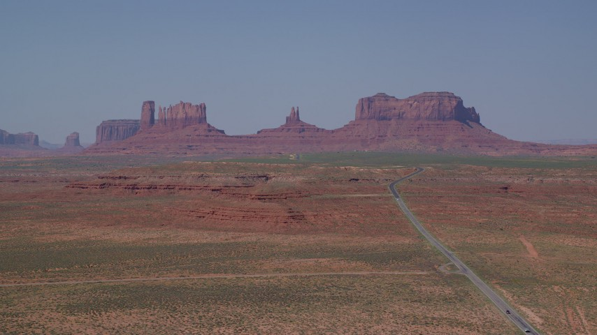 6K stock footage aerial video of a wide view of desert buttes, seen from Highway 163, Monument Valley, Utah, Arizona Aerial Stock Footage | AX135_079