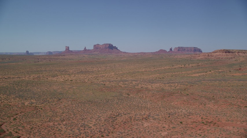 6K stock footage aerial video of a wide view of distant buttes in an open desert valley, Monument Valley, Utah, Arizona Aerial Stock Footage | AX135_084