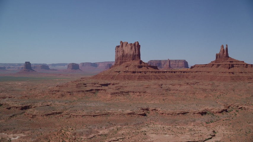 6K stock footage aerial video of approaching buttes in a desert valley, Monument Valley, Utah, Arizona Aerial Stock Footage | AX135_108