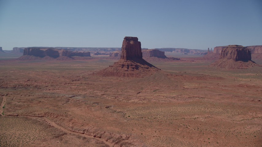 Approaching East Mitten Butte, Monument Valley, Utah, Arizona Aerial Stock Footage | AX135_114