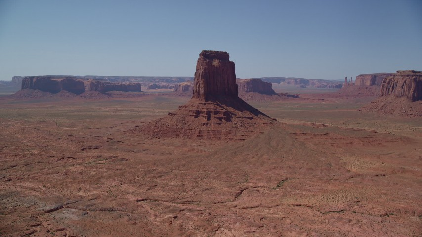 Approaching East Mitten Butte, Monument Valley, Utah, Arizona Aerial Stock Footage | AX135_115