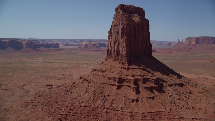Flying by East Mitten Butte, reveal Elephant Butte, Monument Valley, Utah, Arizona Aerial Stock Footage AX135_116