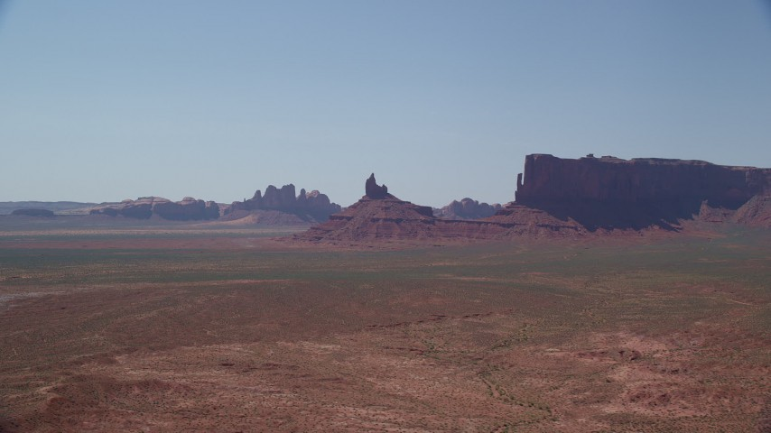 Flying by Rooster Rock, Meridian Butte, Monument Valley, Utah, Arizona Aerial Stock Footage | AX135_122