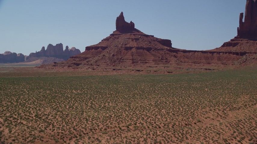 6K stock footage aerial video tilt to reveal and approach Rooster Rock, Monument Valley, Utah, Arizona Aerial Stock Footage | AX135_125