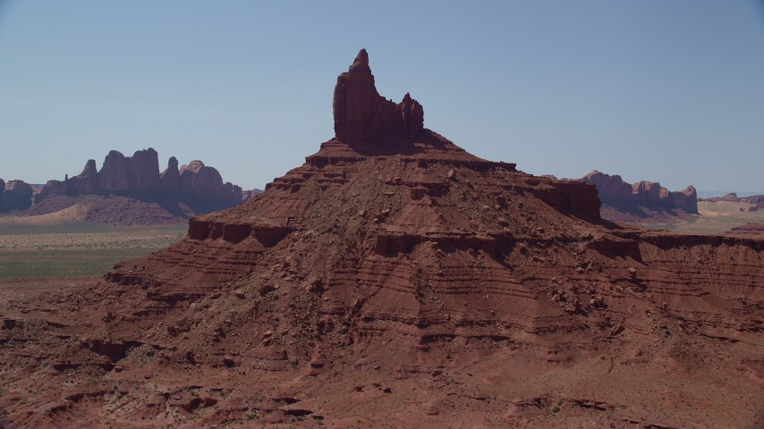 Approaching Rooster Rock, Monument Valley, Utah, Arizona Aerial Stock Footage | AX135_126