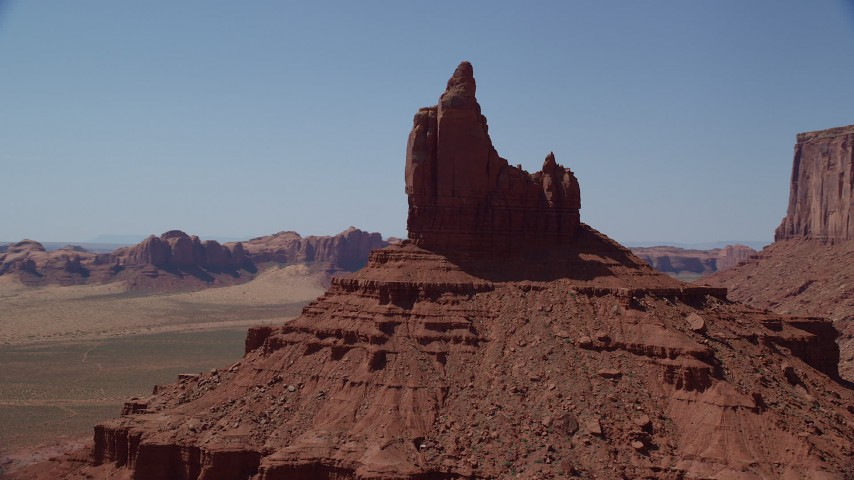 Orbiting Rooster Rock, Monument Valley, Utah, Arizona Aerial Stock Footage AX135_127
