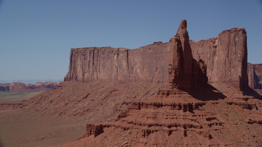 Orbiting Rooster Rock and Meridian Butte, Monument Valley, Utah, Arizona Aerial Stock Footage | AX135_128
