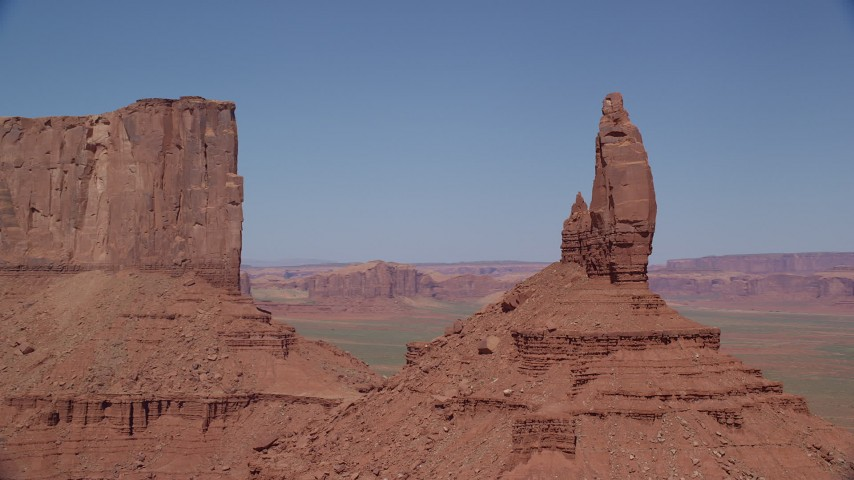 Orbiting Rooster Rock, Monument Valley, Utah, Arizona Aerial Stock Footage | AX135_129