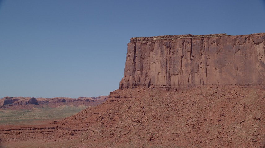 6K stock footage aerial video of flying by cliffs of Meridian Butte, Monument Valley, Utah, Arizona Aerial Stock Footage | AX135_130