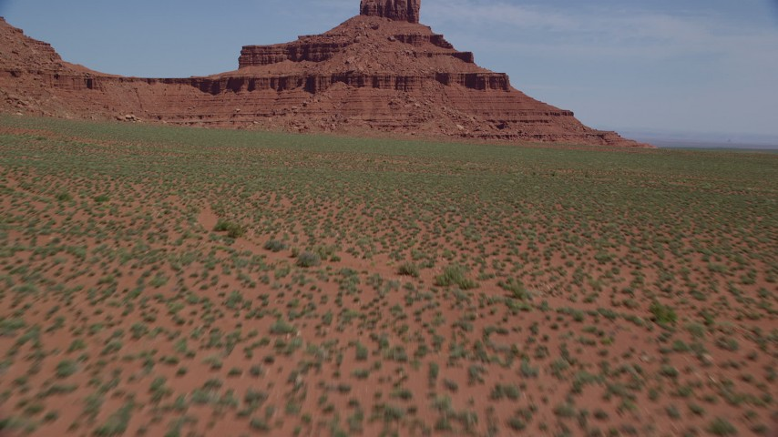 6K stock footage aerial video tilt from from desert to reveal and fly toward Rooster Rock, Monument Valley, Utah, Arizona Aerial Stock Footage | AX135_134