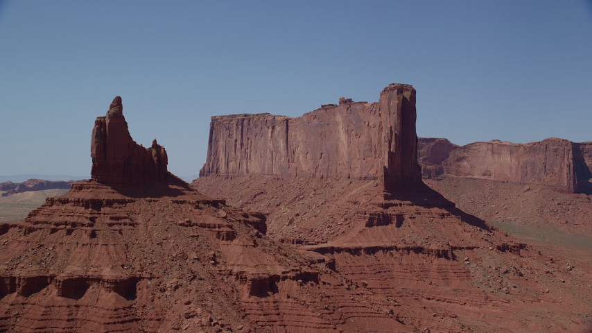 Flying by Rooster Rock, Meridian Butte, Monument Valley, Utah, Arizona Aerial Stock Footage | AX135_138