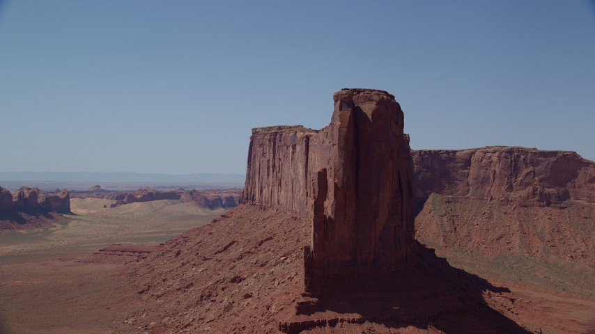 Flying by Meridian Butte, Monument Valley, Utah, Arizona Aerial Stock Footage | AX135_139