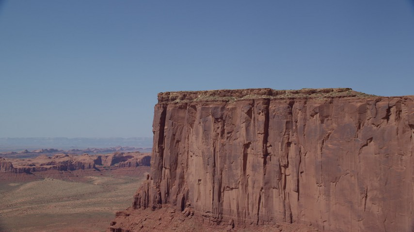 Flying by Meridian Butte, Monument Valley, Utah, Arizona Aerial Stock Footage | AX135_141