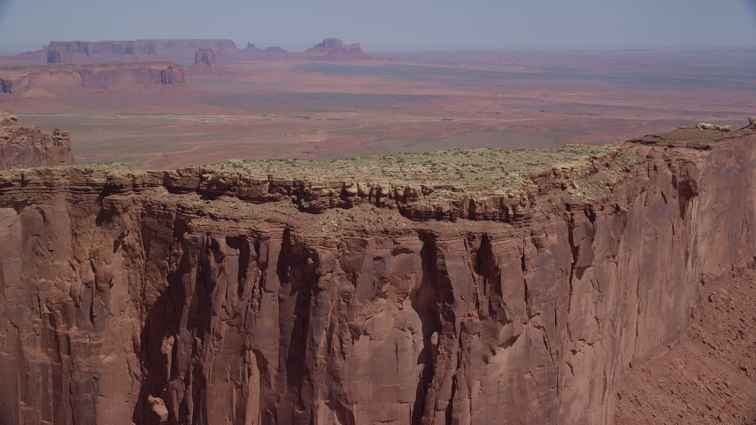 Flying by the top of Meridian Butte, Monument Valley, Utah, Arizona Aerial Stock Footage | AX135_143