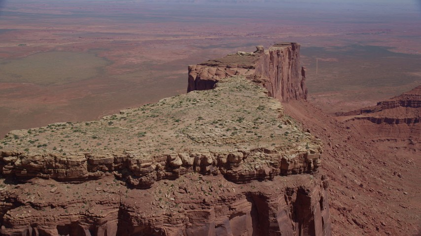 Flying over Meridian Butte, revealing Rooster Rock, Monument Valley, Utah, Arizona Aerial Stock Footage AX135_144
