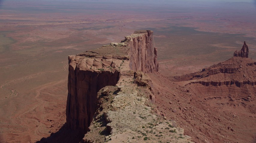 Flying over Meridian Butte near Rooster Rock, Monument Valley, Utah, Arizona Aerial Stock Footage | AX135_145