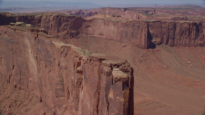 Approaching Meridian Butte, tilt down, Monument Valley, Utah, Arizona Aerial Stock Footage AX135_150