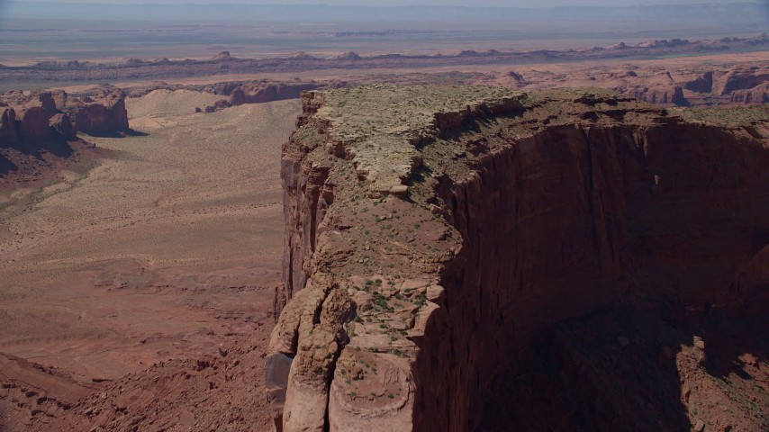 Flying over Meridian Butte, Monument Valley, Utah, Arizona Aerial Stock Footage | AX135_152