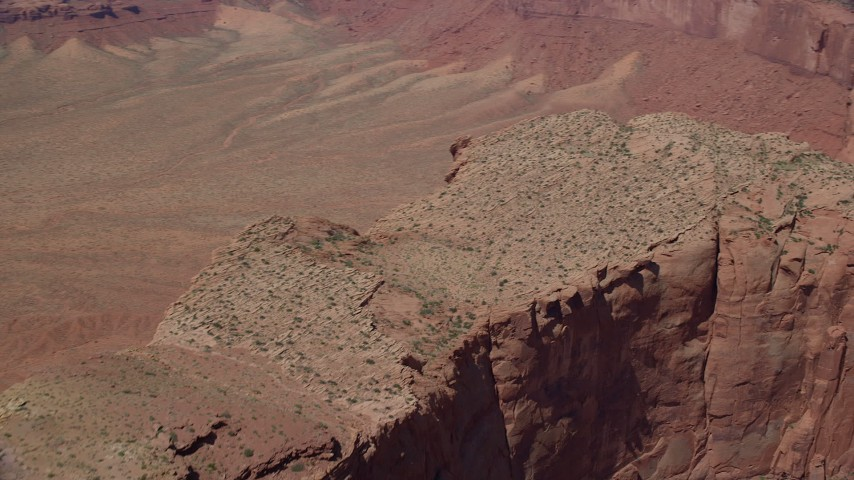 Flying over, pan across Meridian Butte, Monument Valley, Utah, Arizona Aerial Stock Footage | AX135_153