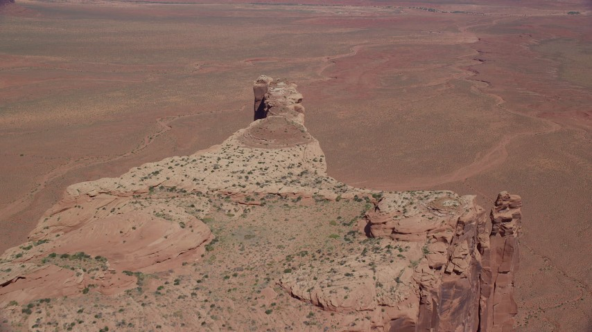 6K stock footage aerial video of flying toward the edge of Meridian Butte, Monument Valley, Utah, Arizona Aerial Stock Footage | AX135_155