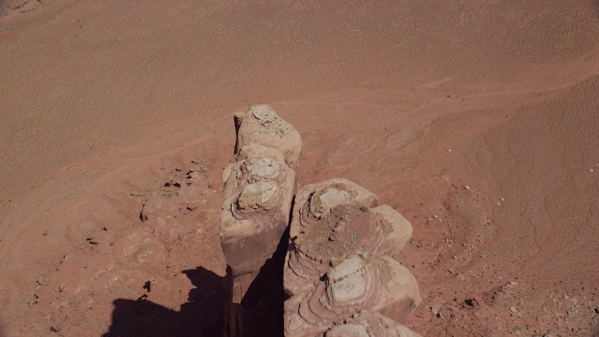 Flying over Meridian Butte, tilt down to bird's eye view, Monument Valley, Utah, Arizona Aerial Stock Footage | AX135_156