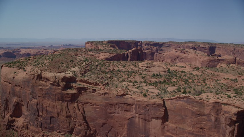 6K stock footage aerial video of flying by top of Hunt's Mesa in Monument Valley, Utah, Arizona Aerial Stock Footage | AX135_158