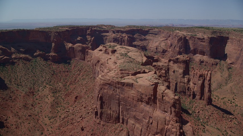 Flying by Hunt's Mesa, Monument Valley, Utah, Arizona Aerial Stock Footage | AX135_164