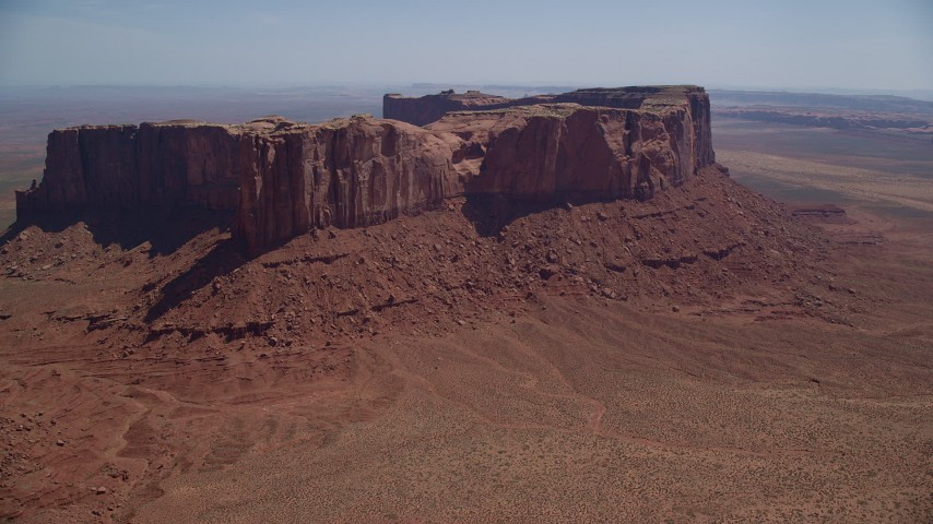 Flying by Meridian Butte, Monument Valley, Utah, Arizona Aerial Stock Footage | AX135_167