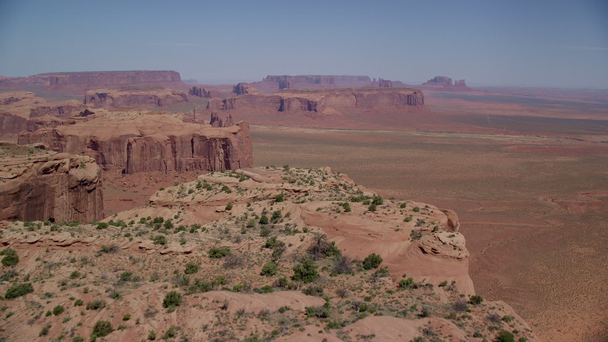 6K stock footage aerial video of flying over the top of Meridian Butte in Monument Valley, Utah, Arizona Aerial Stock Footage | AX135_170