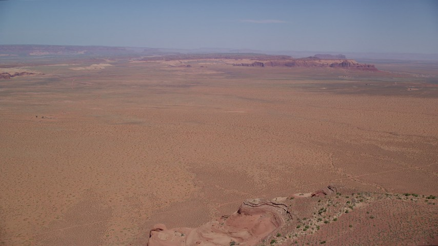 Approaching Oljeto Mesa, Rock Door Mesa, Navajo Nation Reservation, Arizona, Utah Aerial Stock Footage | AX135_189