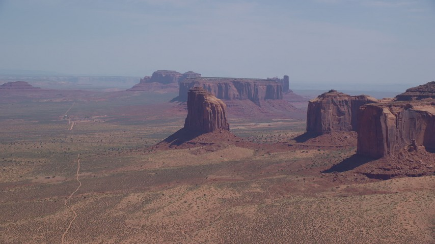 Flying by Gray Whiskers Butte, Monument Valley, Arizona, Utah Aerial Stock Footage | AX135_190
