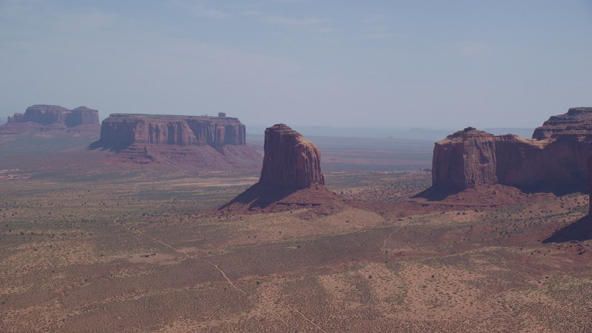 6K stock footage aerial video of passing by Gray Whiskers Butte, Monument Valley, Arizona, Utah Aerial Stock Footage | AX135_191