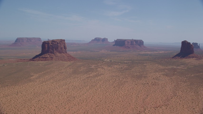 6K stock footage aerial video of flying by open desert with buttes and mesas, Monument Valley, Arizona, Utah Aerial Stock Footage | AX135_192